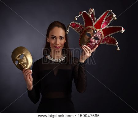 Woman In Black Dress With Carnival Masks