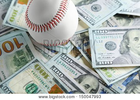 Baseball ball on money bills