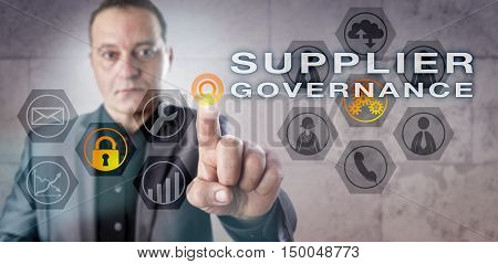 Senior male enterprise executive is looking into SUPPLIER GOVERNANCE onscreen. Business concept touching on E-commerce cyber security data privacy governance risk management and compliance.
