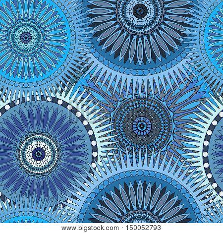 Seamless blue pattern with oriental mandalas. Islam, Arabic, Asian motifs. Kaleidoscope print. Vintage lace mood. Fabric, wallpaper or wrapping.