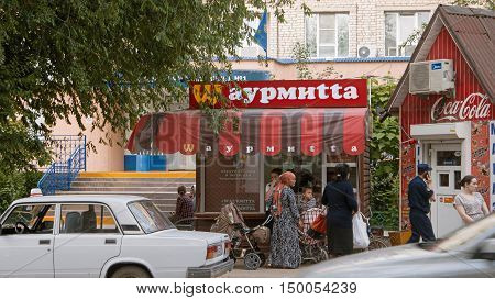 Astrakhan, Russia, May 24, 2016: Brand mimicry example. Local fast food using turned well known M of McDonald's in brand name. McDonald's is the world's largest chain of fast food restaurants.