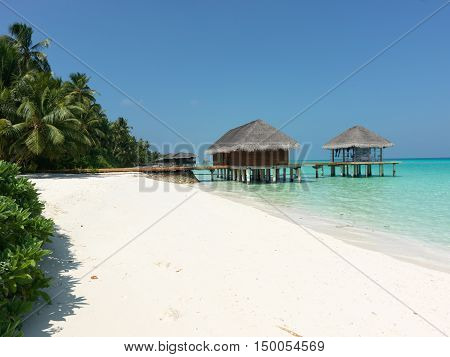 Overwater tropical bungalow on the lagoon - Look closely at the hut right there where my beloved doing relaxing massage. I love the Maldives.