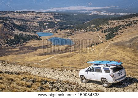 LEADVILLE, CO, USA - SEPTEMBER 27, 2016: Toyota 4Runner SUV (2016 Trail edition) with a paddleboard descending  from the Mosquito Pass on a rocky jeep trail in Colorado's Rocky Mountains