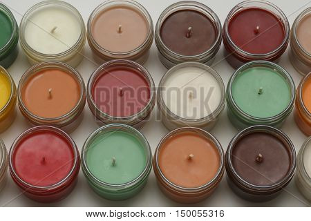 very colorful candles sitting neatly in rows