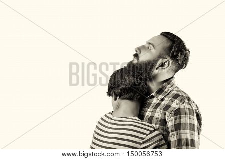 Black and white isolated portrait of a bearded guy who hugs a girl (wife girlfriend). The image symbolizes: care tenderness love allegiance protection ... There is a spase for your text.