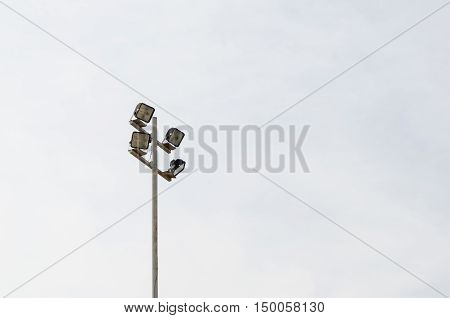Stadium light tower metal pole on sky