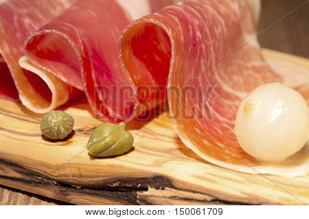 Prosciutto with the pickled onion and caper