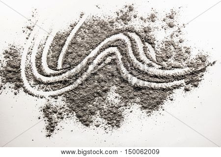 Wave shape illustration drawing made in pile of grey ash sand dust