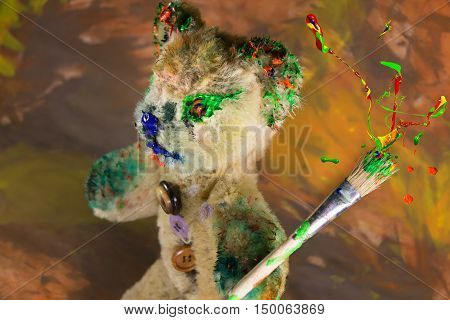 Wizard teddy bear toy make magic with colorful paint burst on the paintbrush