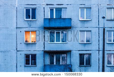 Wall with Iluminated window. Detail of soviet era block apartment building