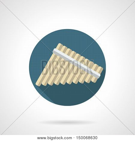 Panpipes symbol. Multi-lateral flute, consisting of several hollow tubes of different lengths. Woodwind musical instruments theme. Round flat color design vector icon.