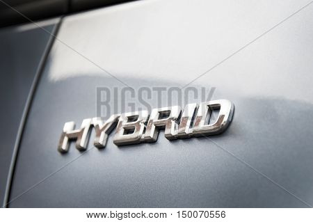 Hybrid inscription on the body of a modern car