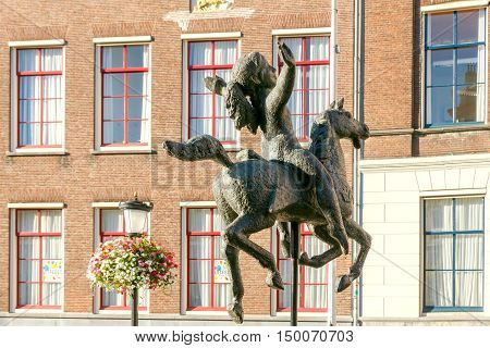 Utrecht. Netherlands - August 24 2016: Sculpture of a girl on a horse on one of the central squares of Utrecht. In Utrihte are trained more than 100 000 students. Urban art is a creative approach.
