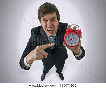 Discipline at work concept. Fury and angry manager is showing clock. poster