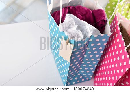 Three Bags Colored With New Clothes Inside Elevated View