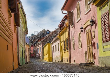 Beautiful traditional street inside citadel of Sighisoara (house of Dracula) in Transylvania region Romania