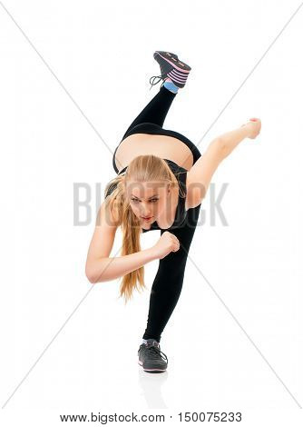 Young woman doing fitness exercise, isolated on white background. Full lenght portrait of beautiful athlete girl doing gym exercise in studio.