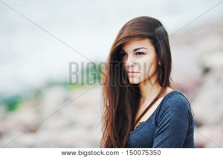 Beautiful long-haired woman on the Gulf of Finland close-up.
