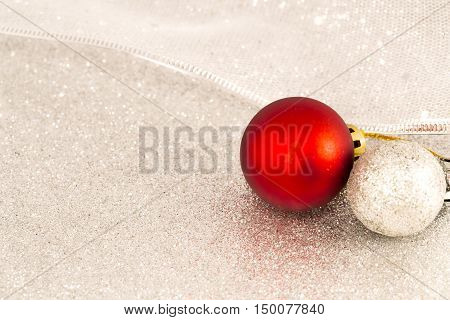 Christmas balls on a shinny silver background