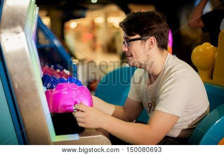 Young Man Have Fun On The Game Room