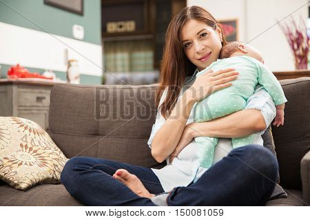 Cute Hispanic Woman With A Newborn