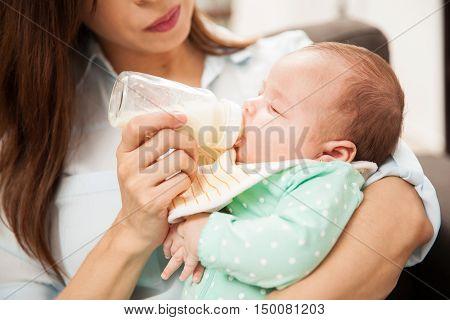 Newborn Baby Drinking Some Milk