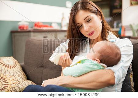 Attractive Brunette Feeding Her Baby