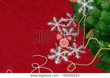 Happy New Year and Merry Christmas on a red background with snowflakes toy tree