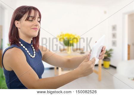 a beautiful  young girl with a tablet