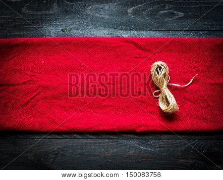 Red Tablecloth On Old Wooden Background