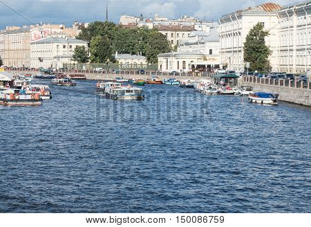Saint Petersburg Russia September 10 2016: Excursion ships in the river of Fontanka. The view from Anichkov bridge in St. Petersburg Russia.