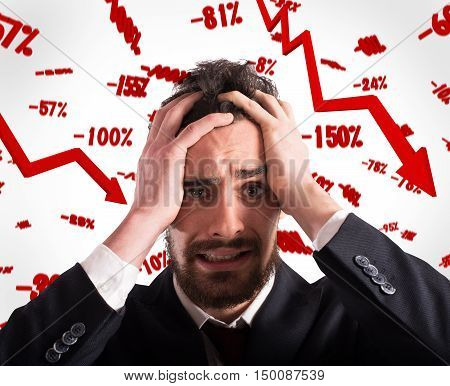 Desperate and discouraged businessman with rates falling background