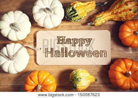 Happy Halloween Message With Colorful Pumpkins