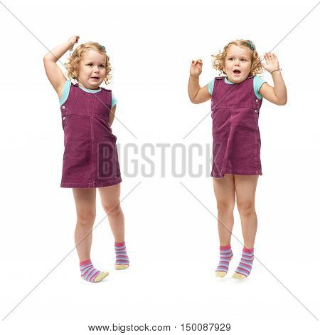 Young little indignant girl with curly hair in purple dress standing over isolated white background