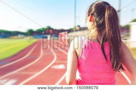 Female Jogging On At A Stadium Track
