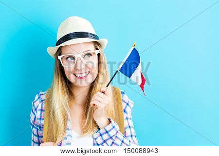 Young Traveling Woman Holding French Flag