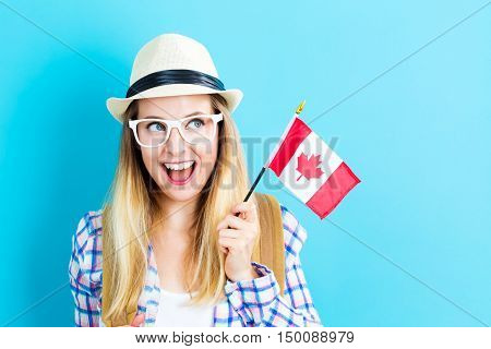 Young Traveling Woman Holding Canadian Flag