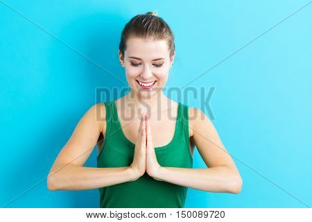Happy Young Woman Practicing Meditation