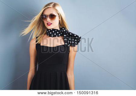 Beautiful Blonde Woman In A Black Dress