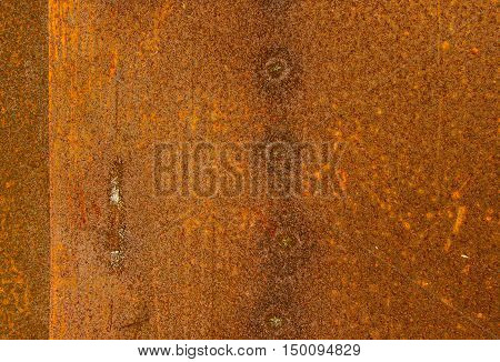 sheet metal rust two lie on one another on one sheet of traces of welding in the form of light spots.