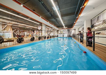 MOSCOW, RUSSIA - APR 02, 2016: Pool area with children at remote models shop on territory of Aviapark shopping center. Aviapark total area of 390 000 sq. m., shopping area - 230,000 sq.m.
