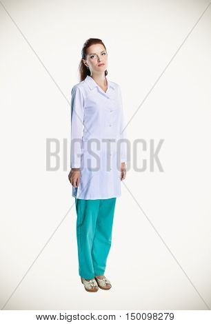 Smiling female doctor  in uniform standing at hospital