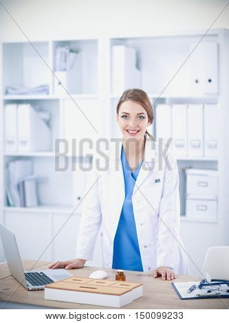Portrait of happy successful young female doctor holding a stethoscope