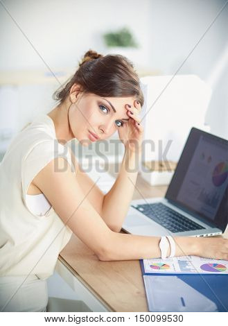 Young and beautiful businesswoman tired from work in the office