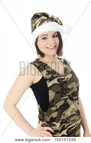 A beautiful teen girl  happily wearing a sleeveless camouflage shirt and  a Santa-style camouflage hat.  On a white background.