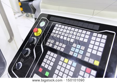 The emergency button or emergency knob of CNC milling machine with the control panel.The control panel of CNC milling machine