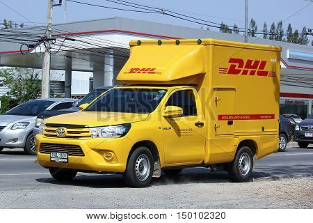 CHIANGMAI THAILAND -FEBRUARY 29 2016: DHL Express and Logistics Container Pickup truck. Modify from Toyota Hilux Revo. Photo at road no 121 about 8 km from downtown Chiangmai thailand.