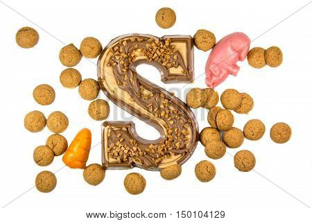 Decorated Chocolate letter with pepernoten and marzipan as Sinterklaas decoration on white background for dutch sinterklaasfeest holiday event on december 5th