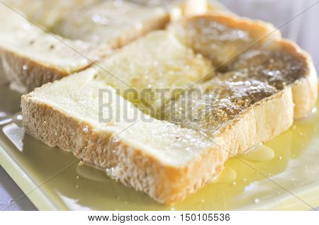 toast with butter topping dish , bread