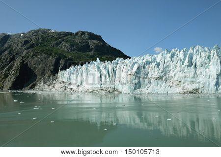 tidewater glacier glistening in the sunlight in Glacier Bay national Park Alaska
